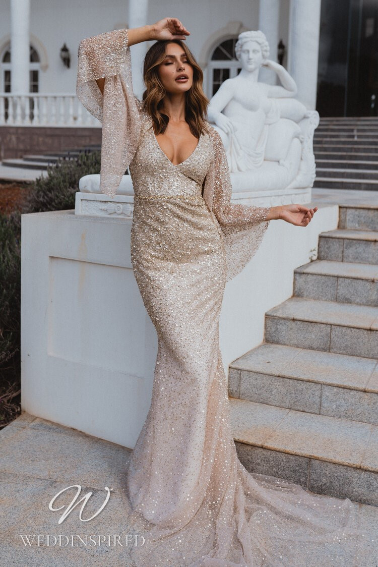 An Anna Campbell 2021 champagne sparkly mermaid wedding dress with a v neck