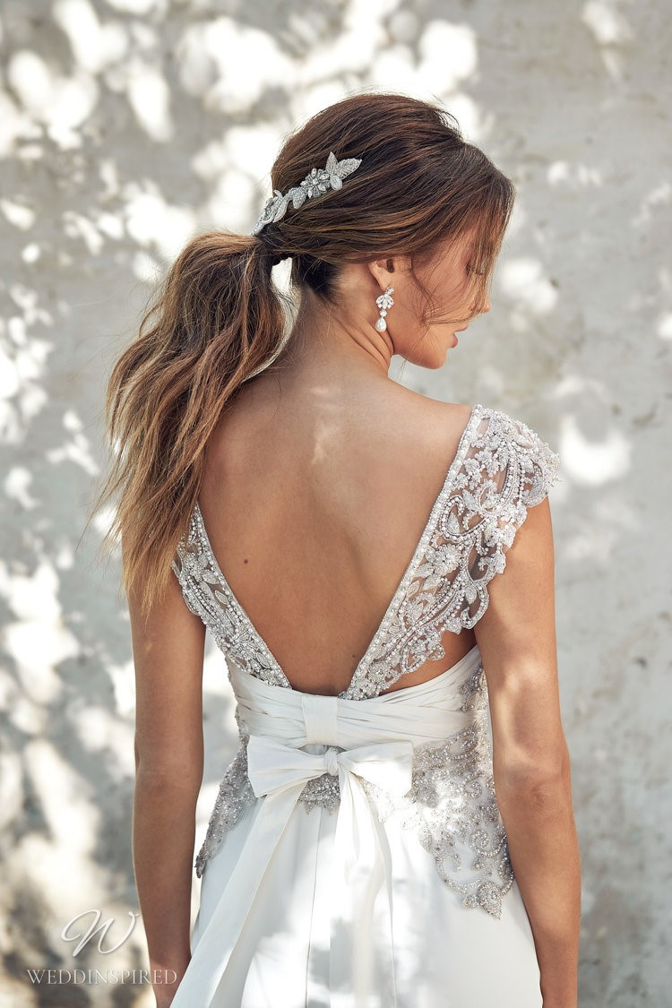 An Anna Campbell 2020 A-line wedding dress with a low back, beading and a bow