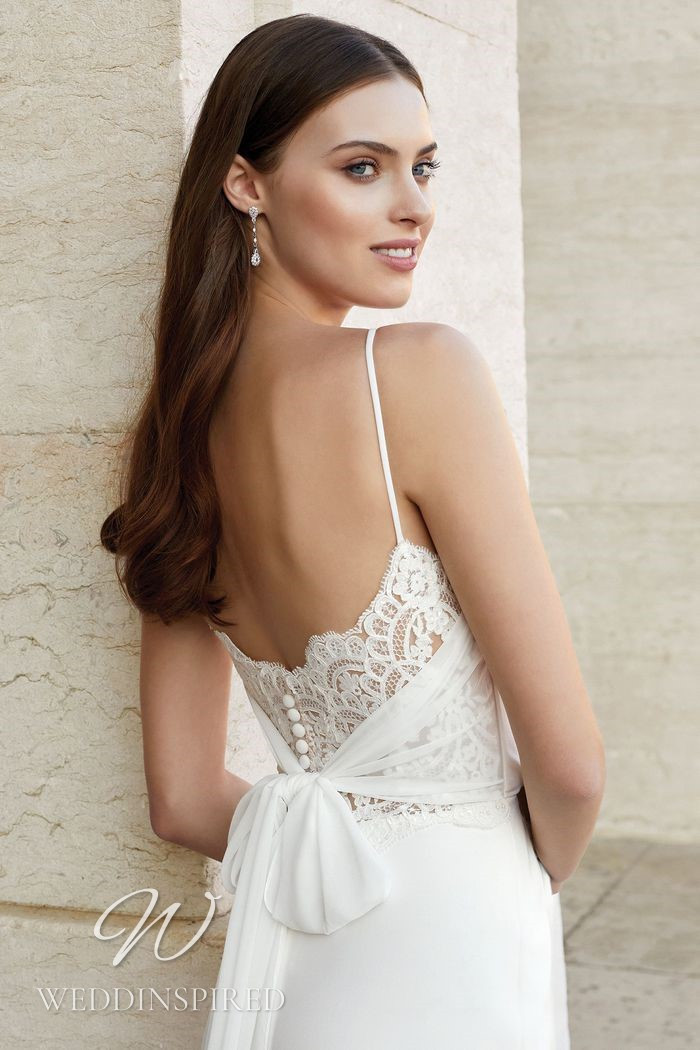 A Justin Alexander 2021 lace and chiffon mermaid wedding dress with straps