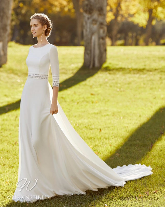 An Aire Barcelona 2021 flowy A-line wedding dress with half sleeves and a high neckline