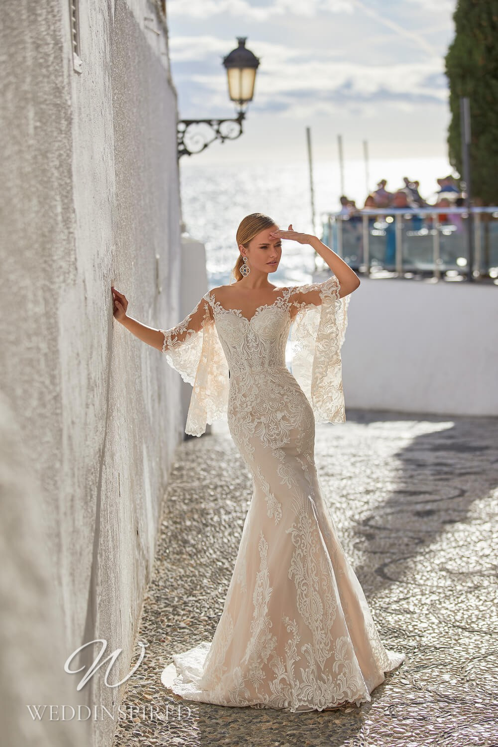 An Essential by Lussano 2021 lace mermaid wedding dress with bell sleeves