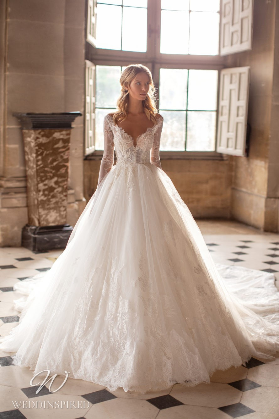 A Milla Nova lace princess ball gown wedding dress with long sleeves
