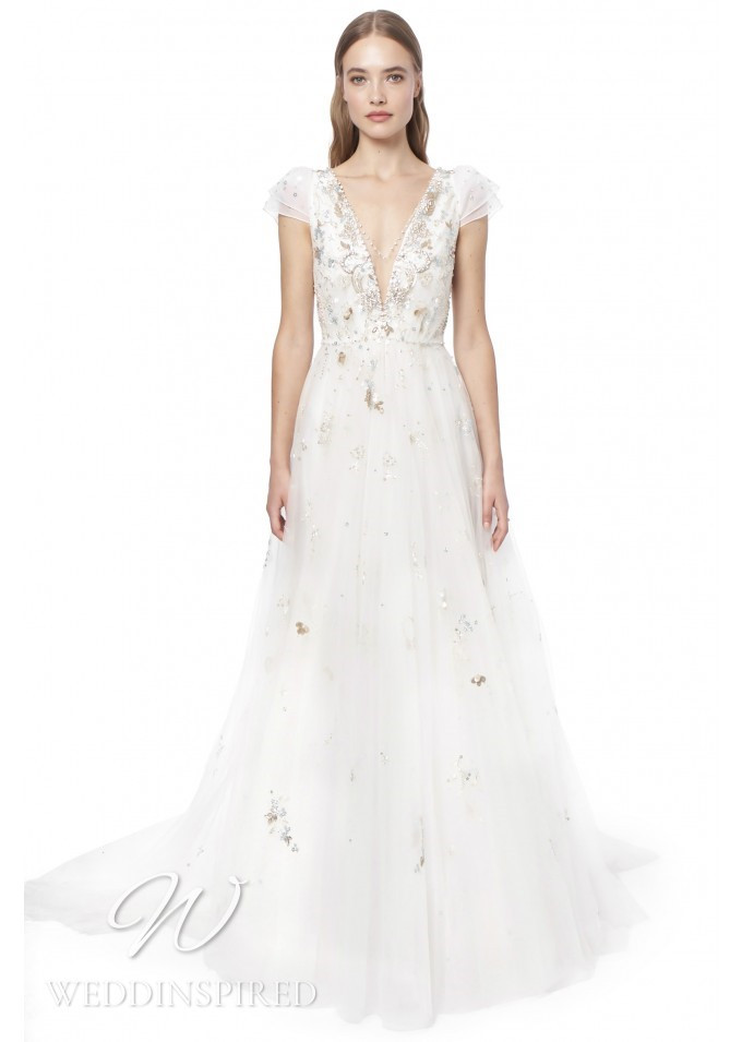 A Jenny Packham 2021 tulle A-line wedding dress with a v neckline and cap sleeves