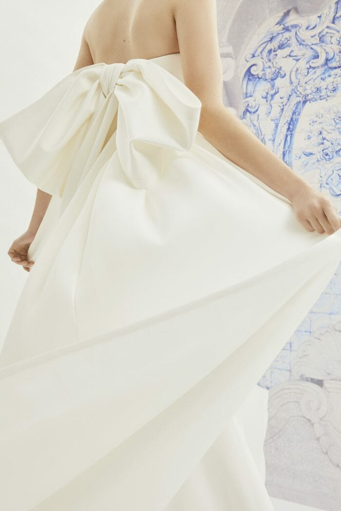 A Carolina Herrera simple strapless crepe sheath wedding dress with a bow