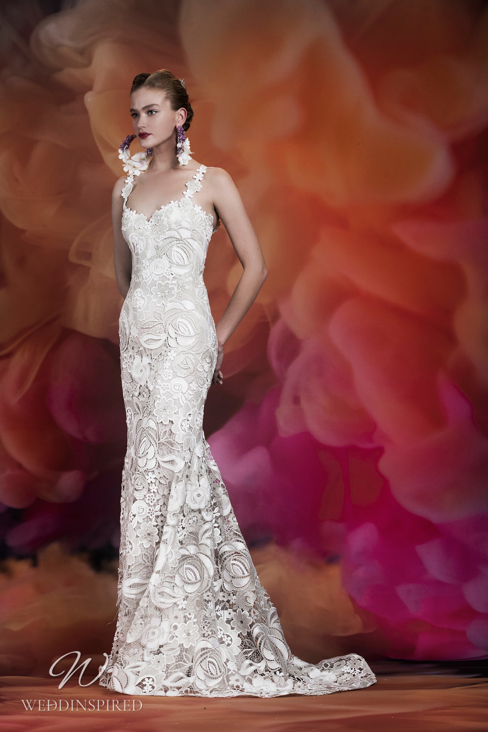 A Naeem Khan intricate lace mermaid wedding dress with flower straps