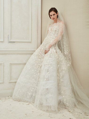 An off the shoulder, ball gown wedding dress with long sleeves and lace