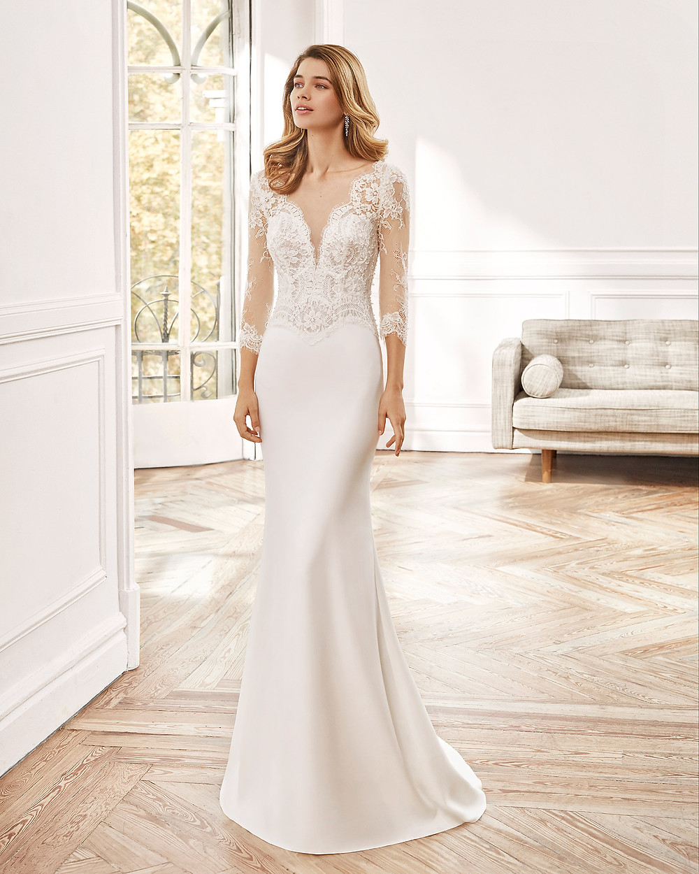 An Aire Barcelona 2020 lace and crepe mermaid wedding dress with half sleeves and a v neckline