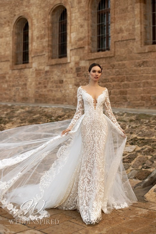 An Ida Torez 2021 lace mermaid wedding dress with long sleeves and a tulle detachable skirt