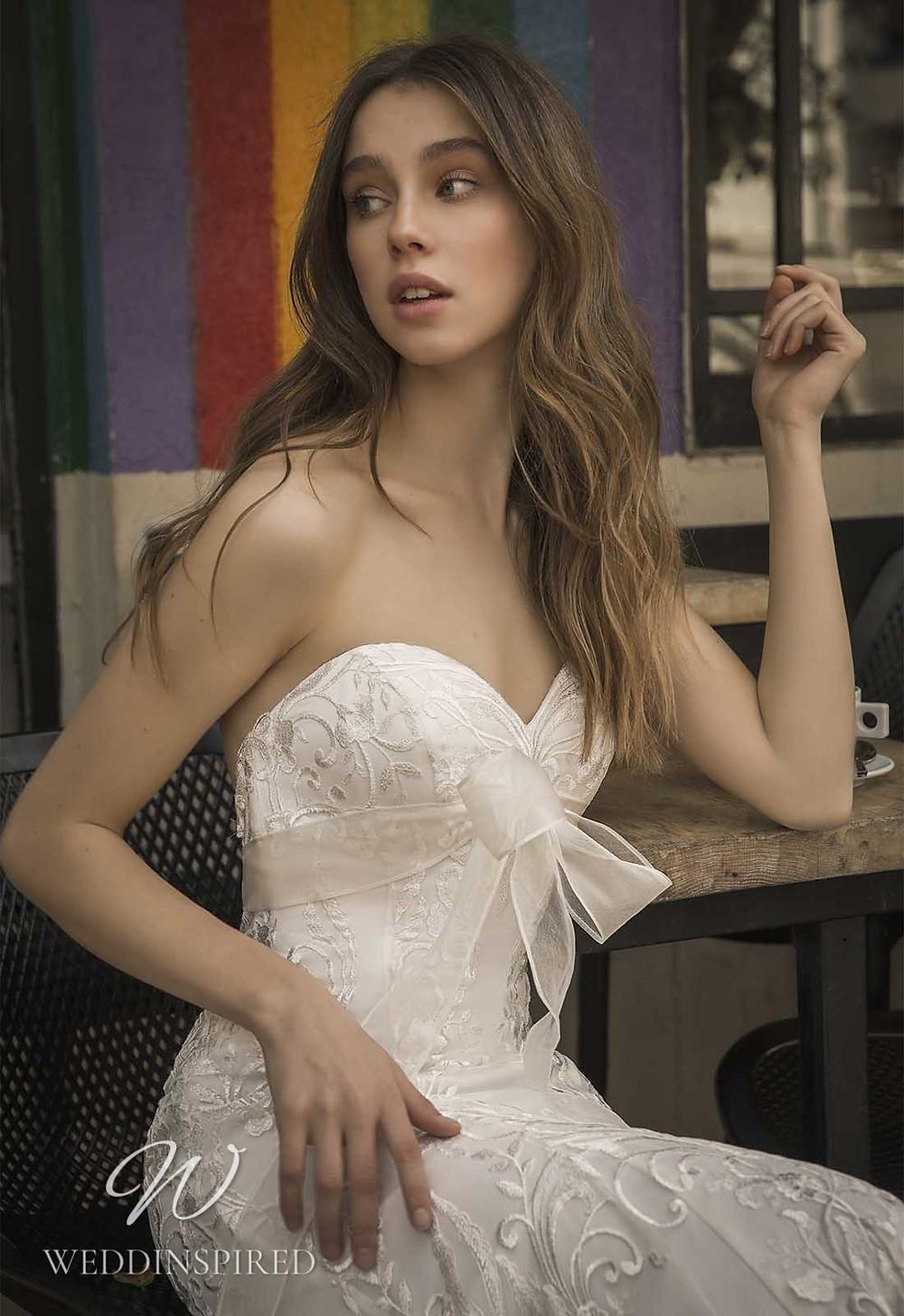 A Pnina Tornai 2021 strapless lace mermaid wedding dress