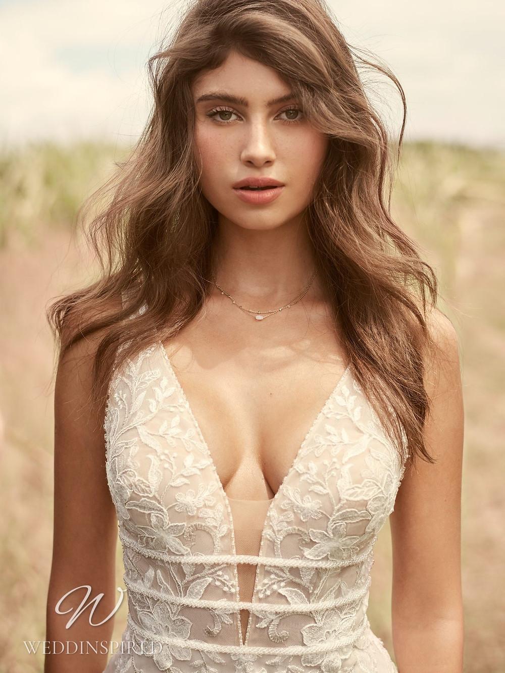 A Rebecca Ingram Spring 2021 lace mermaid wedding dress with a v neck