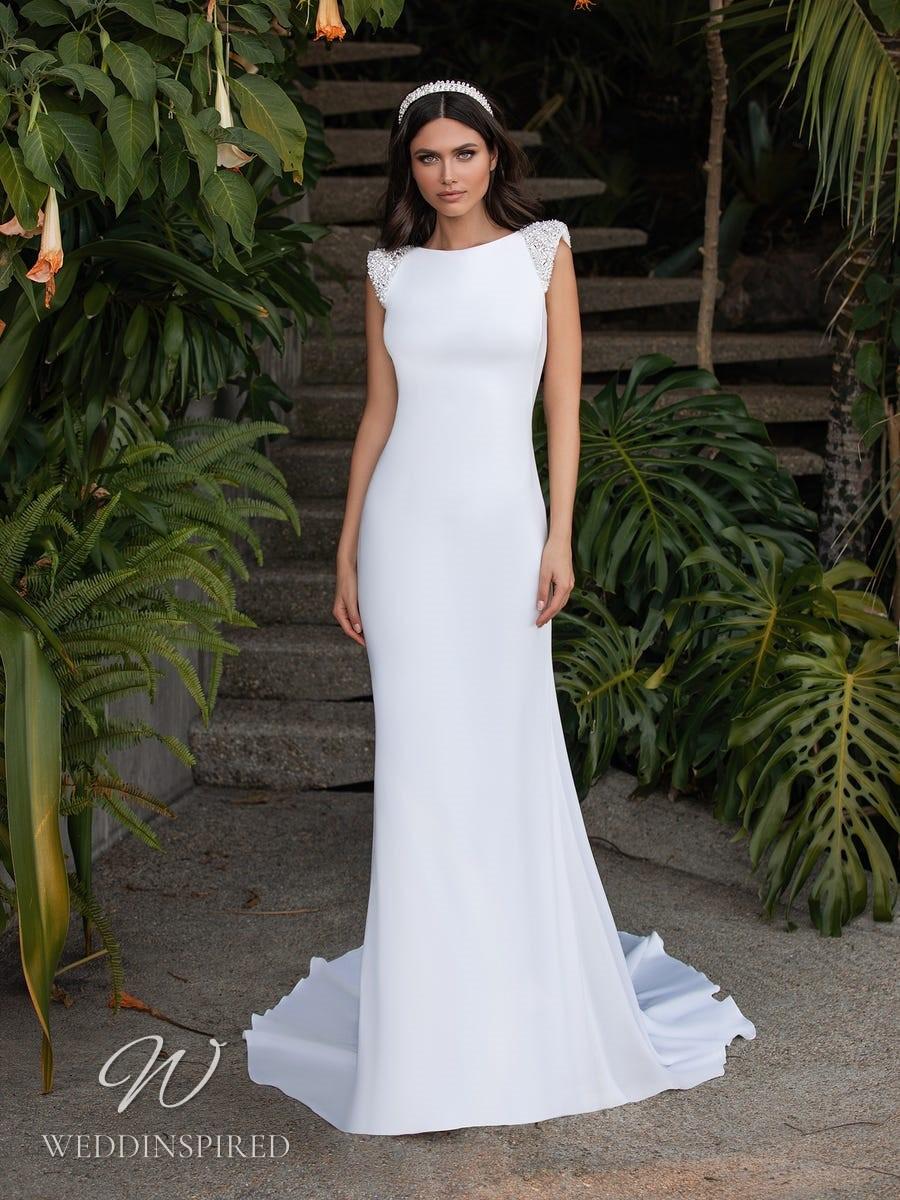 A Pronovias 2021 simple satin mermaid wedding dress with cap sleeves