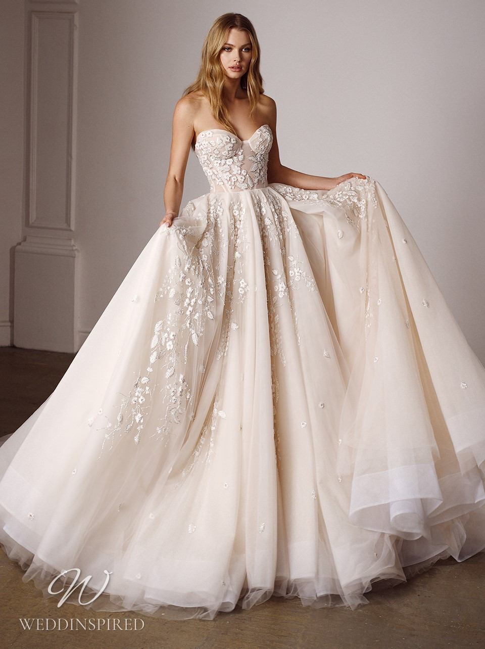 A Galia Lahav 2022 strapless blush lace and tulle A-line wedding dress