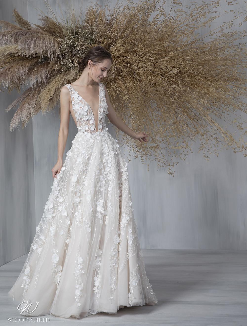 A Tony Ward 2021 floral A-line wedding dress with a v neckline