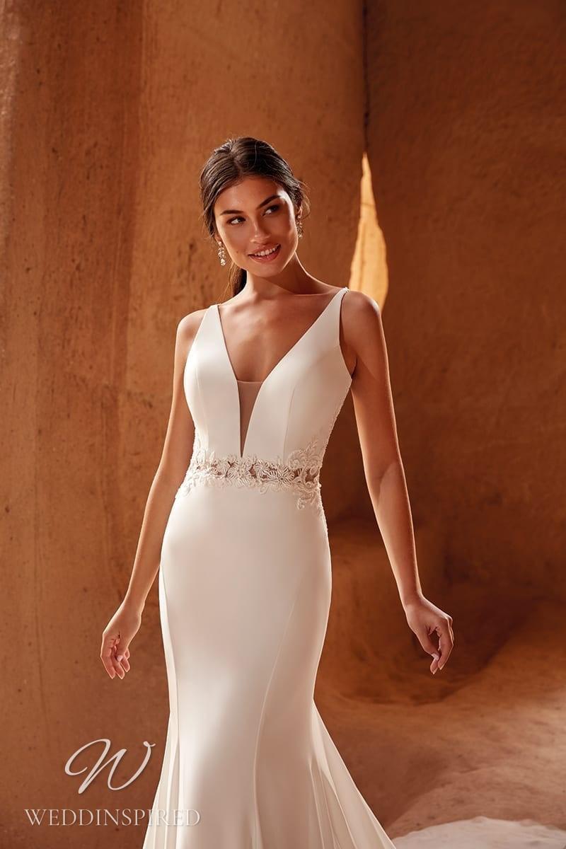 An Eddy K 2021 simple satin mermaid wedding dress with a v neck
