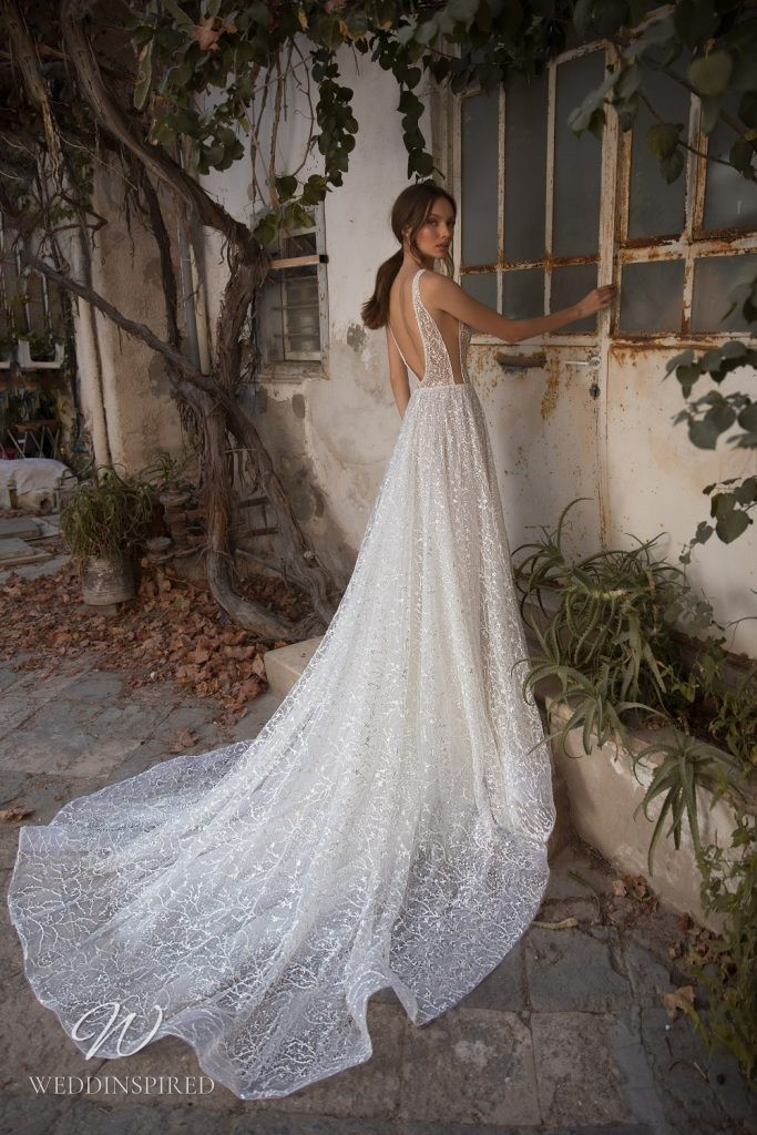 An Eden Aharon 2020 floral sparkly mesh A-line wedding dress with straps and a v neckline
