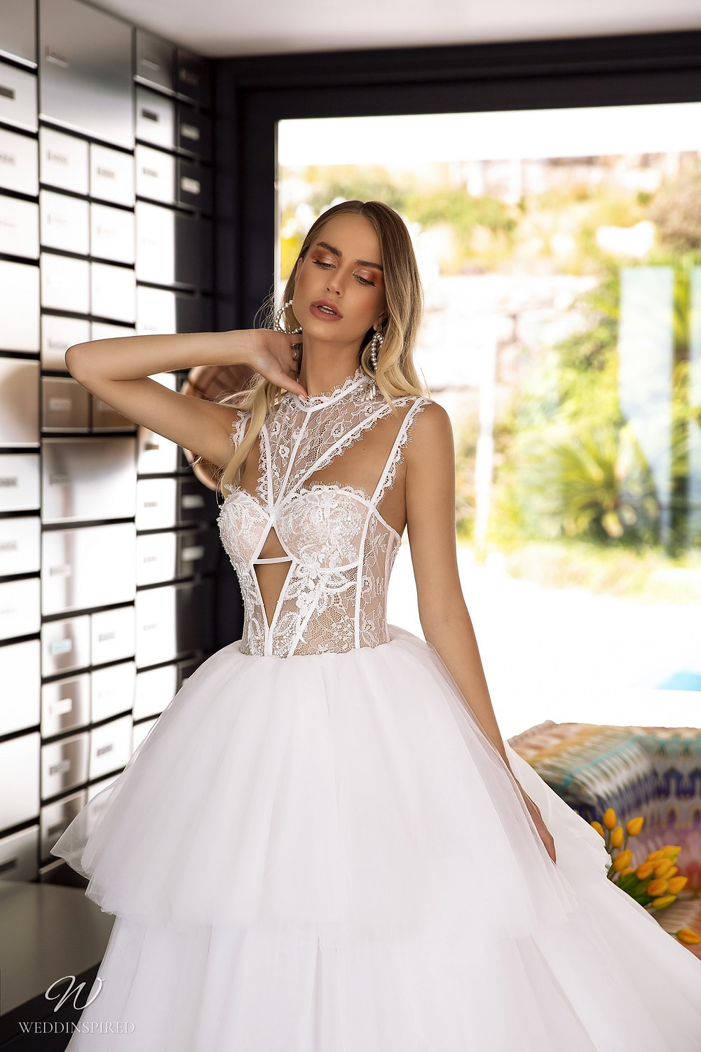 A Tina Valerdi lace and tulle ball gown wedding dress with a ruffle skirt