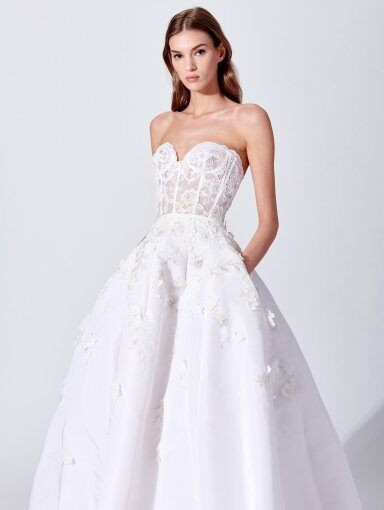 An Oscar de la Renta strapless crepe ball gown wedding dress with pockets and a sweetheart neckline