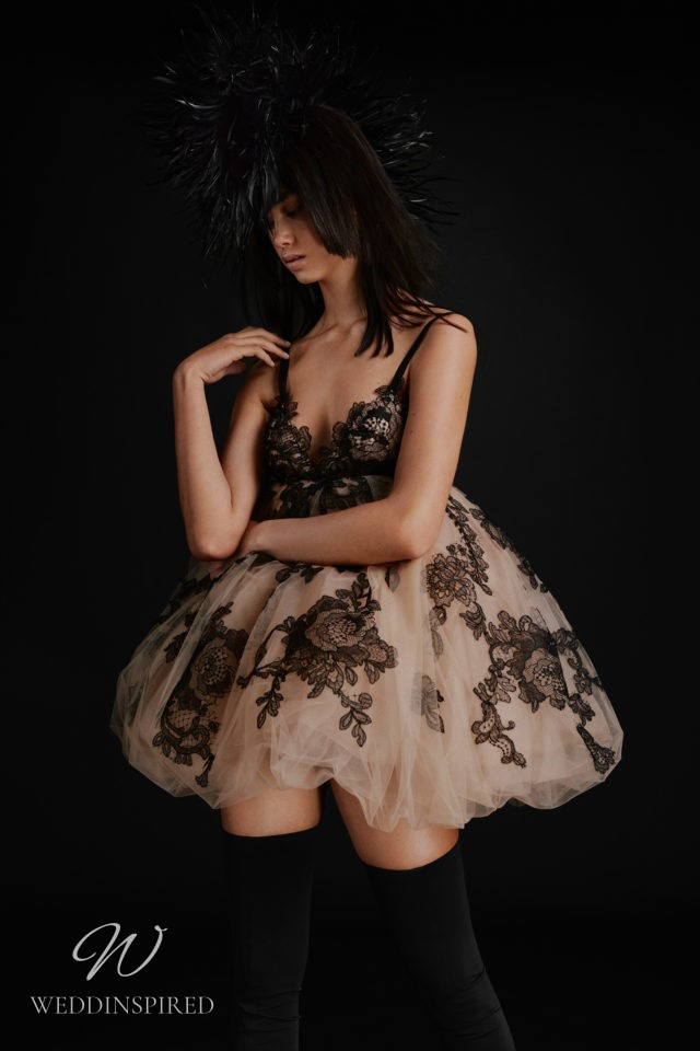 A Vera Wang Fall 2021 nude and black tulle and lace short baby doll wedding dress