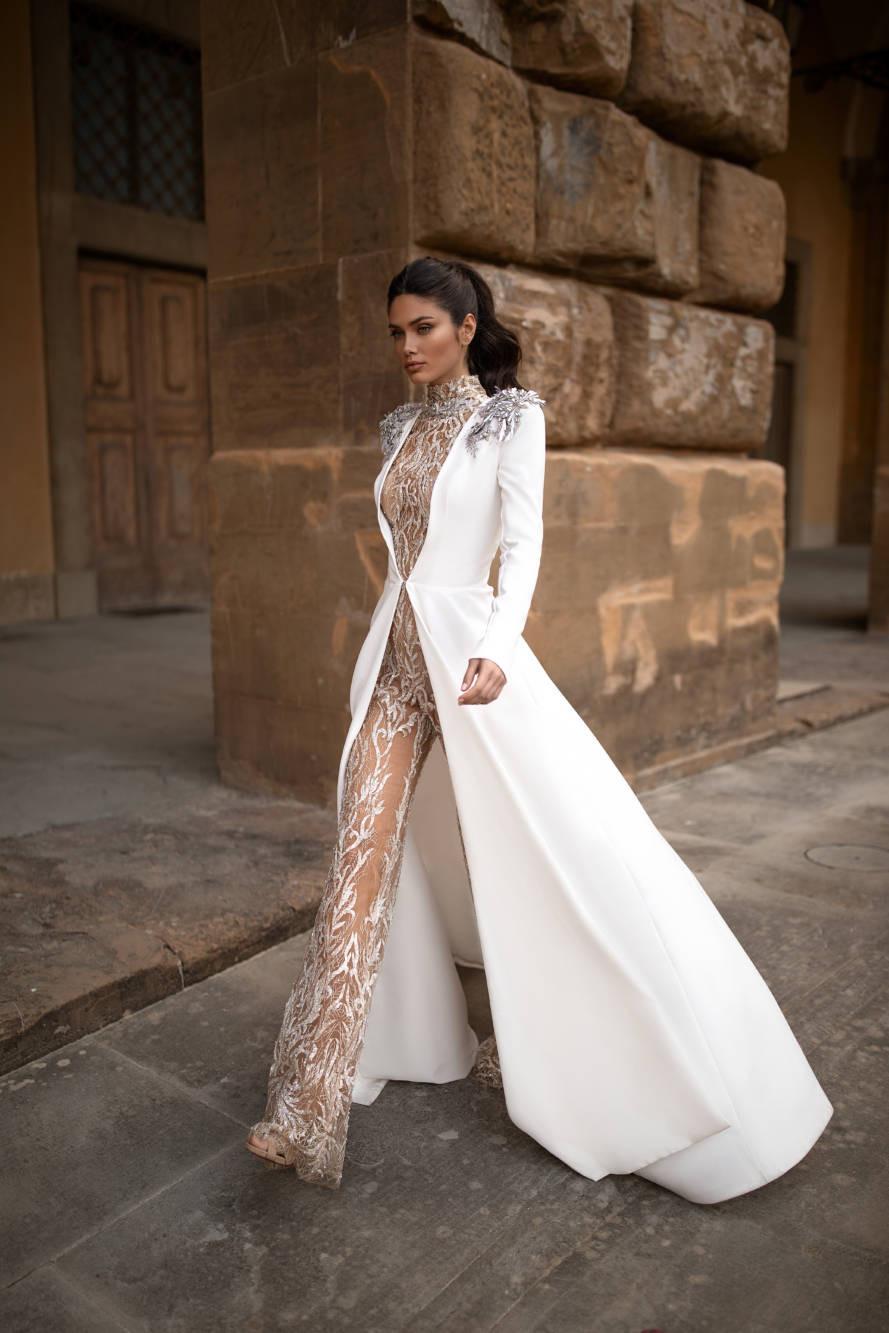A Milla Nova lace wedding jumpsuit or pantsuit with a jacket cape