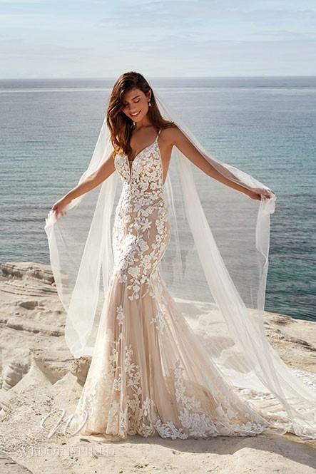 An Eddy K 2022 blush lace mermaid wedding dress