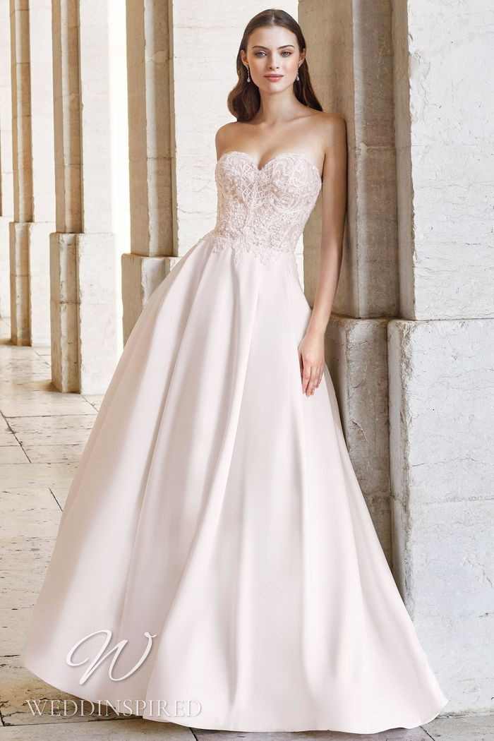 A Justin Alexander 2021 strapless lace and satin A-line wedding dress