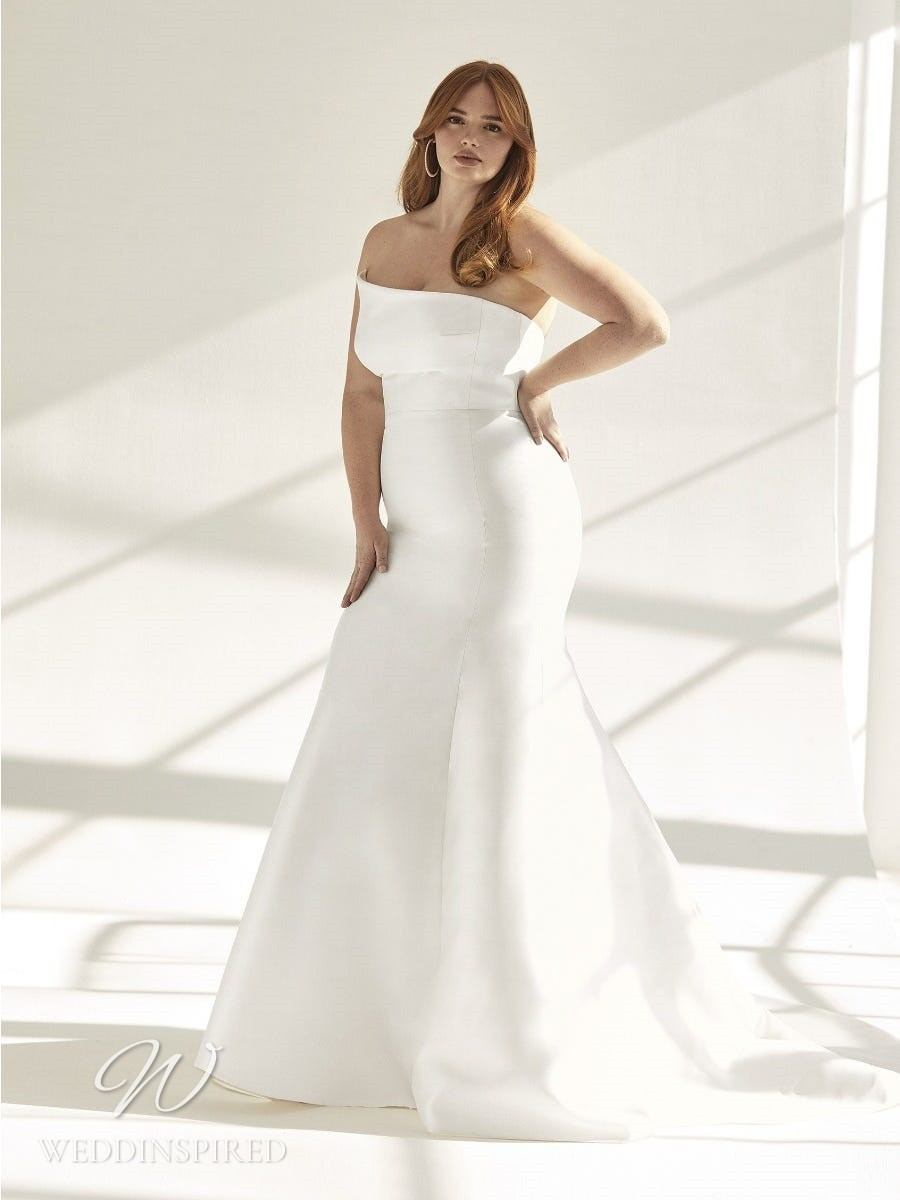 An Ashley Graham x Pronovias 2021 plus size simple strapless satin mermaid wedding dress