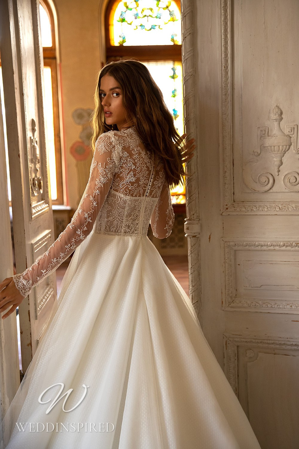 A WONÁ Concept 2021 lace and tulle princess wedding dress with long sleeves