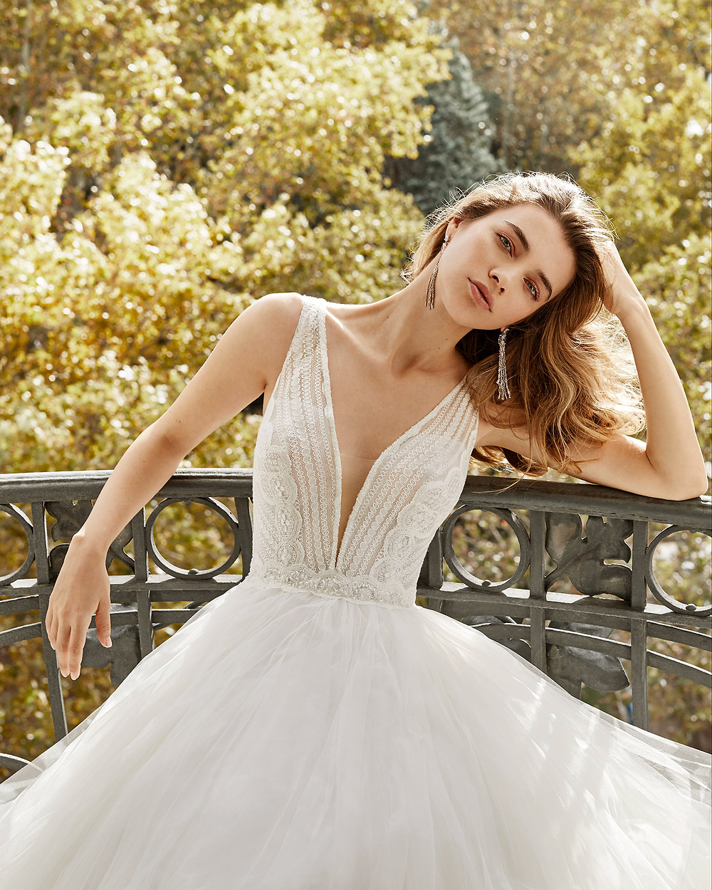 An Aire Barcelona 2020 lace and tulle ball gown wedding dress with a v neckline