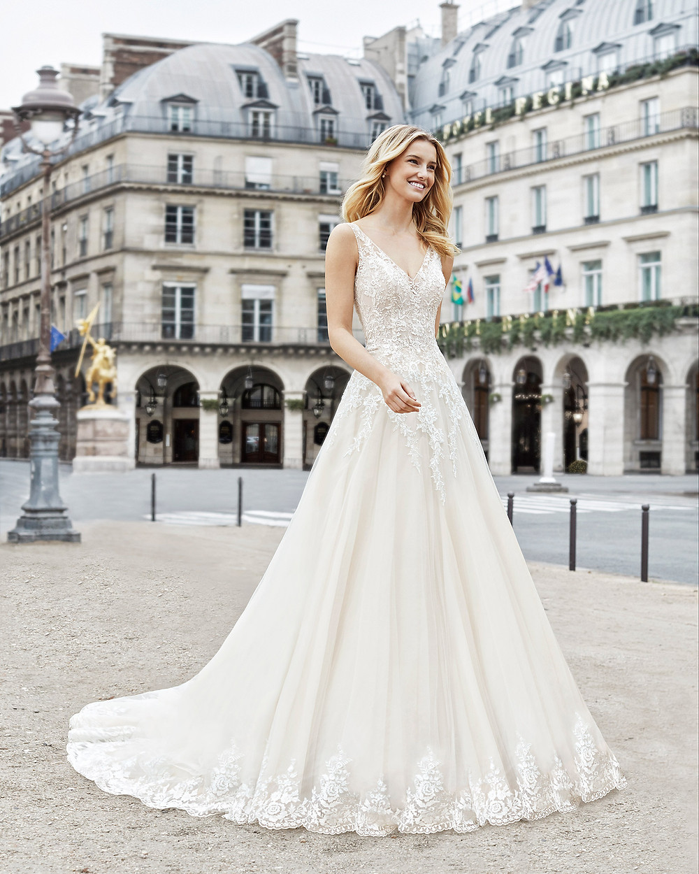 An Aire Barcelona 2020 romantic ivory lace and tulle A-line wedding dress with a v neckline