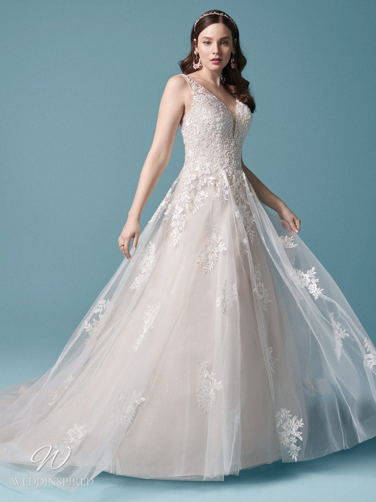 A Maggie Sottero 2021 lace and tulle ball gown wedding dress with straps