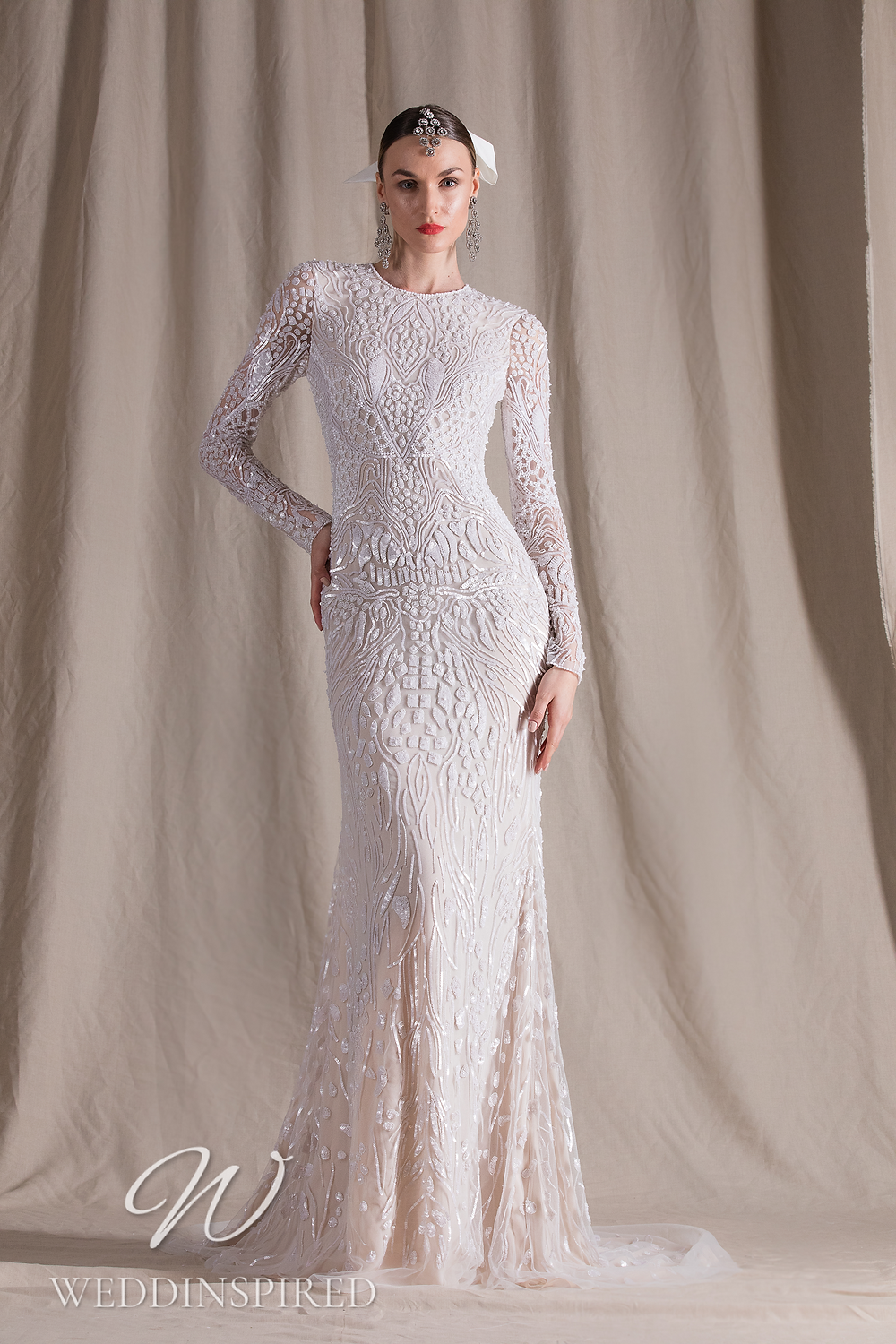 A Naeem Khan 2022 lace and tulle sheath wedding dress with long sleeves