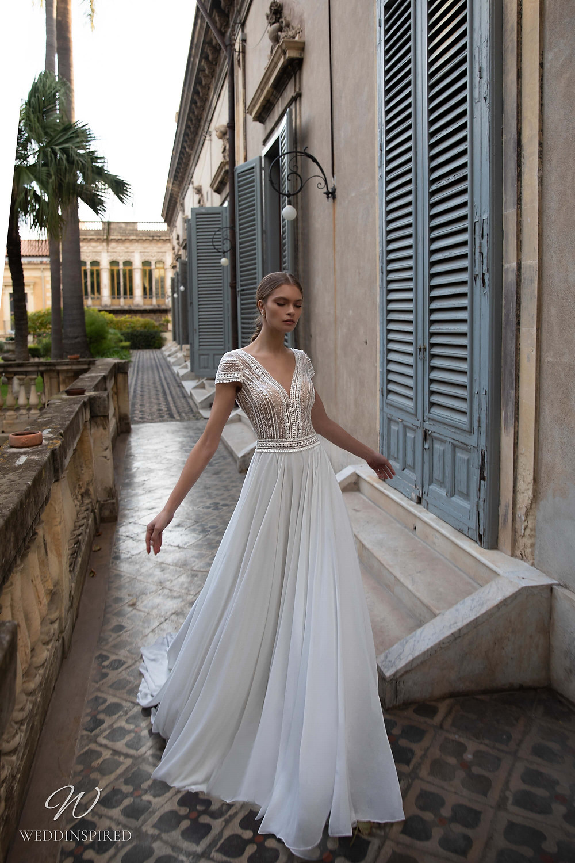 A Naviblue beaded flowy chiffon A-line wedding dress with cap sleaves
