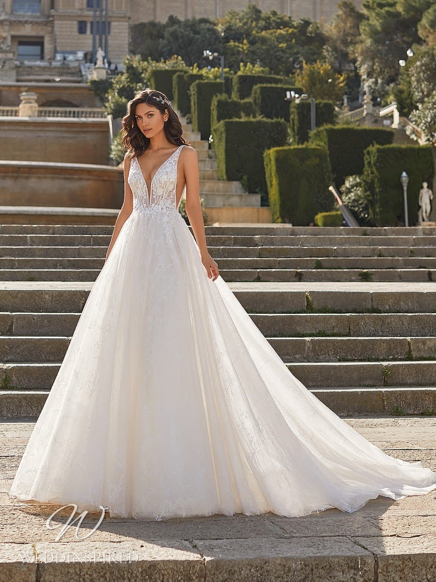 A Pronovias Privée 2021 lace and mesh princess ball gown wedding dress with straps and a v neck