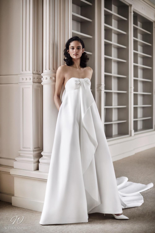 A Viktor & Rolf 2021 empire waist wedding dress with ruffles and a train