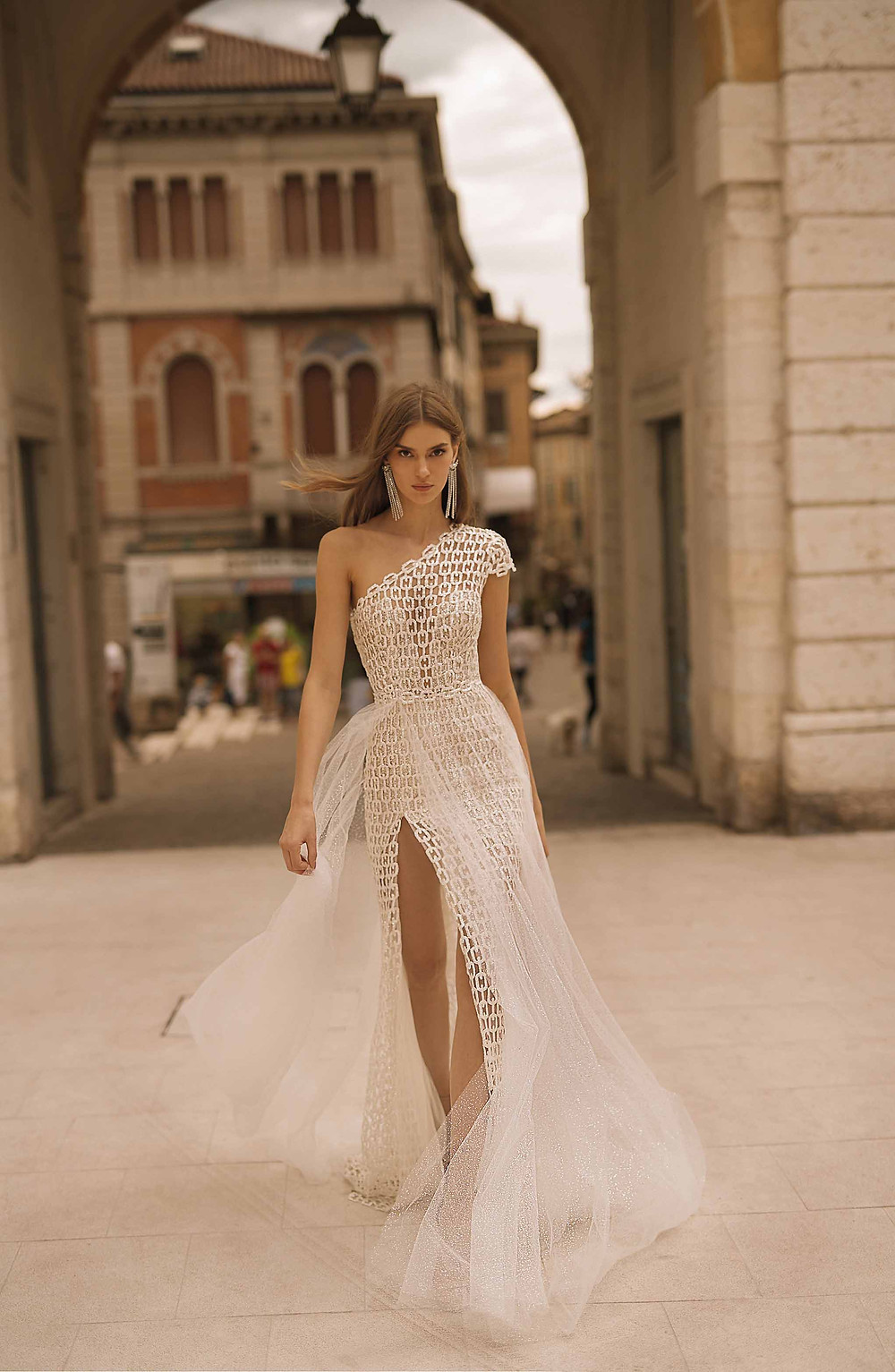 A Berta one sleeve A-line wedding dress, with chain print design and a tulle detachable skirt or overskirt