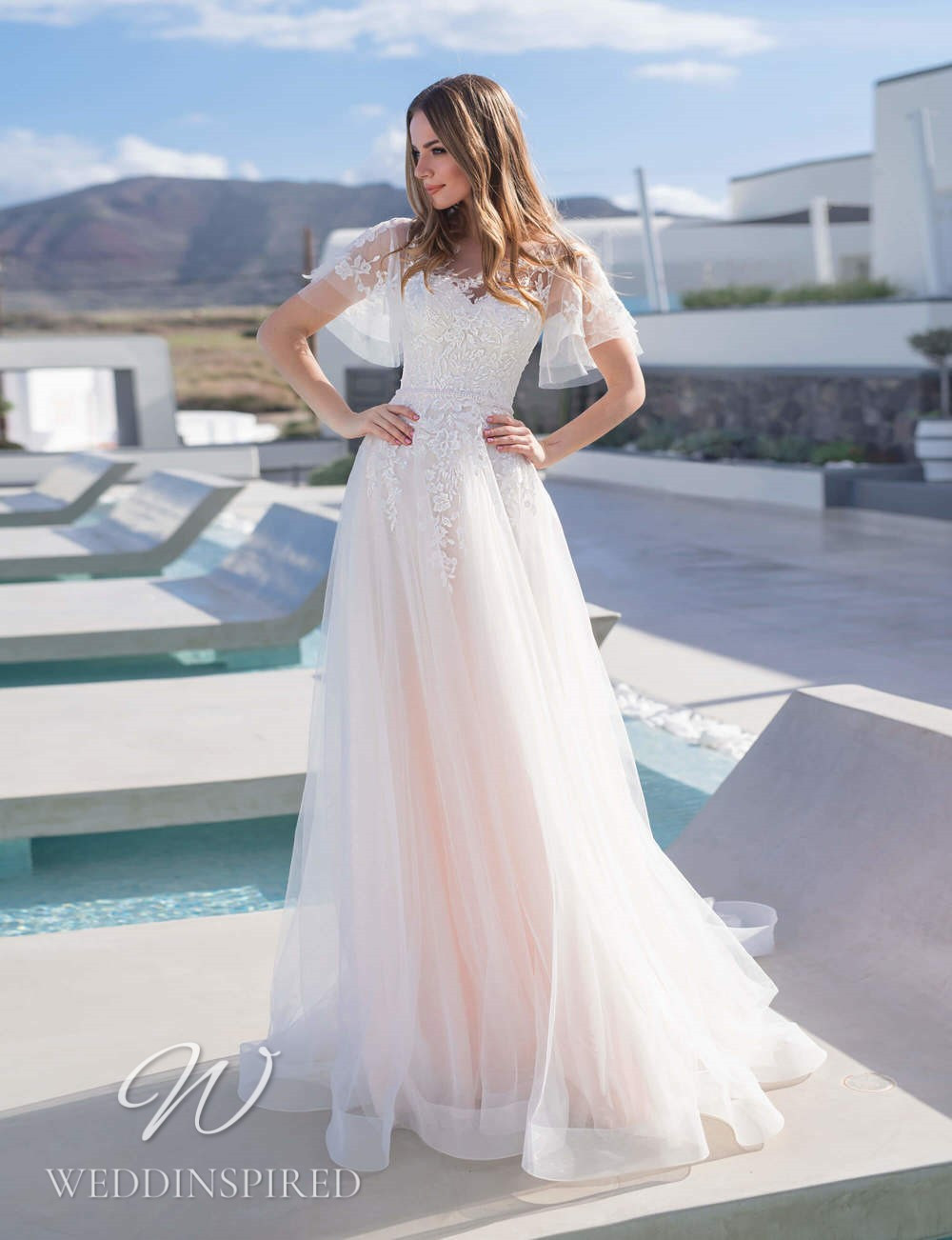 A Blunny 2021 blush lace and tulle A-line wedding dress