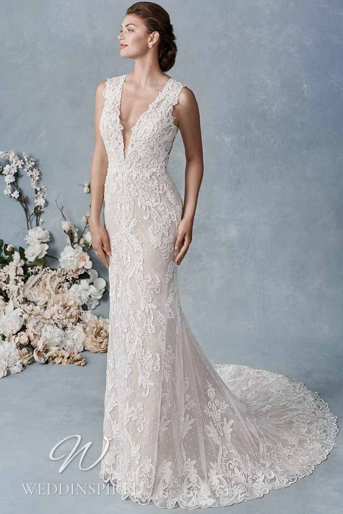 A Kenneth Winston 2021 lace mermaid wedding dress with a v neck