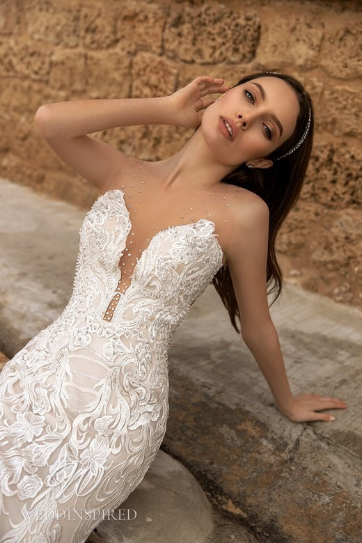 An Ida Torez 2021 lace mermaid wedding dress with an illusion bodice