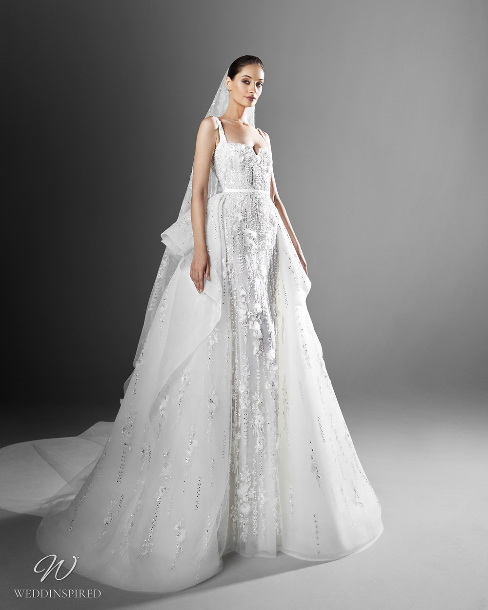 A Zuhair Murad mermaid wedding dress with a detachable skirt and crystals