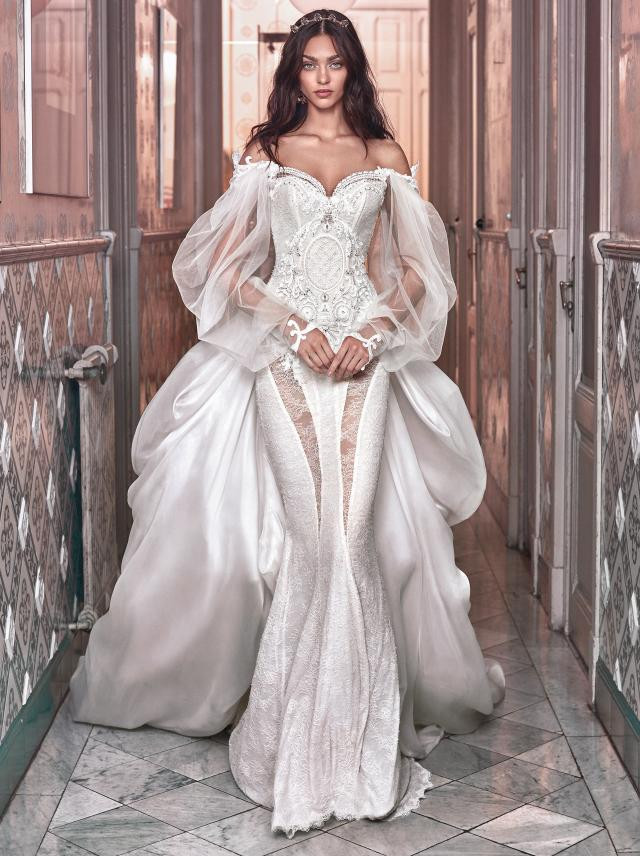 An off the shoulder mermaid wedding dress, with long sleeves, corset and tulle detachable skirt