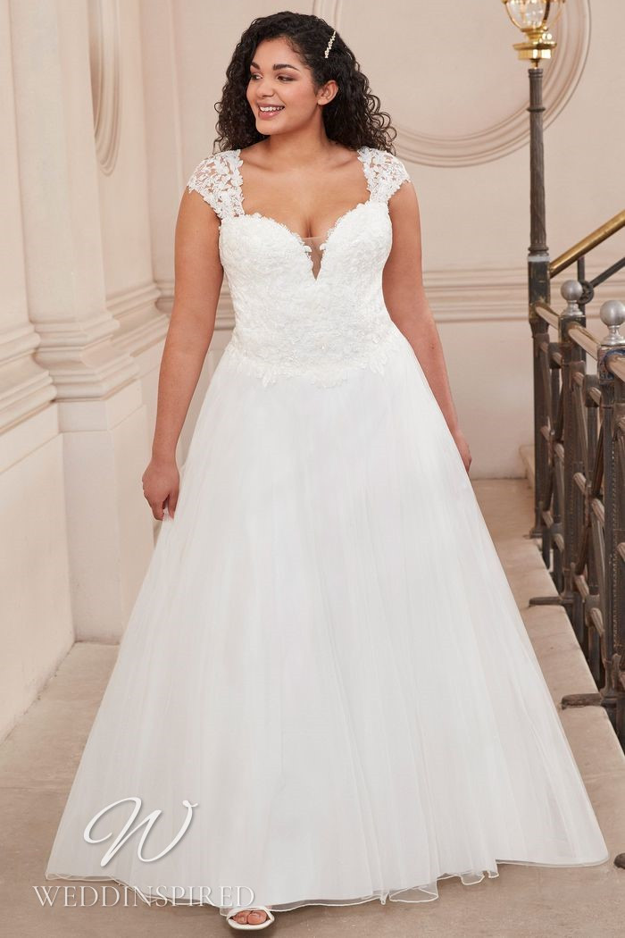 A Justin Alexander 2021 plus size lace and tulle A-line wedding dress