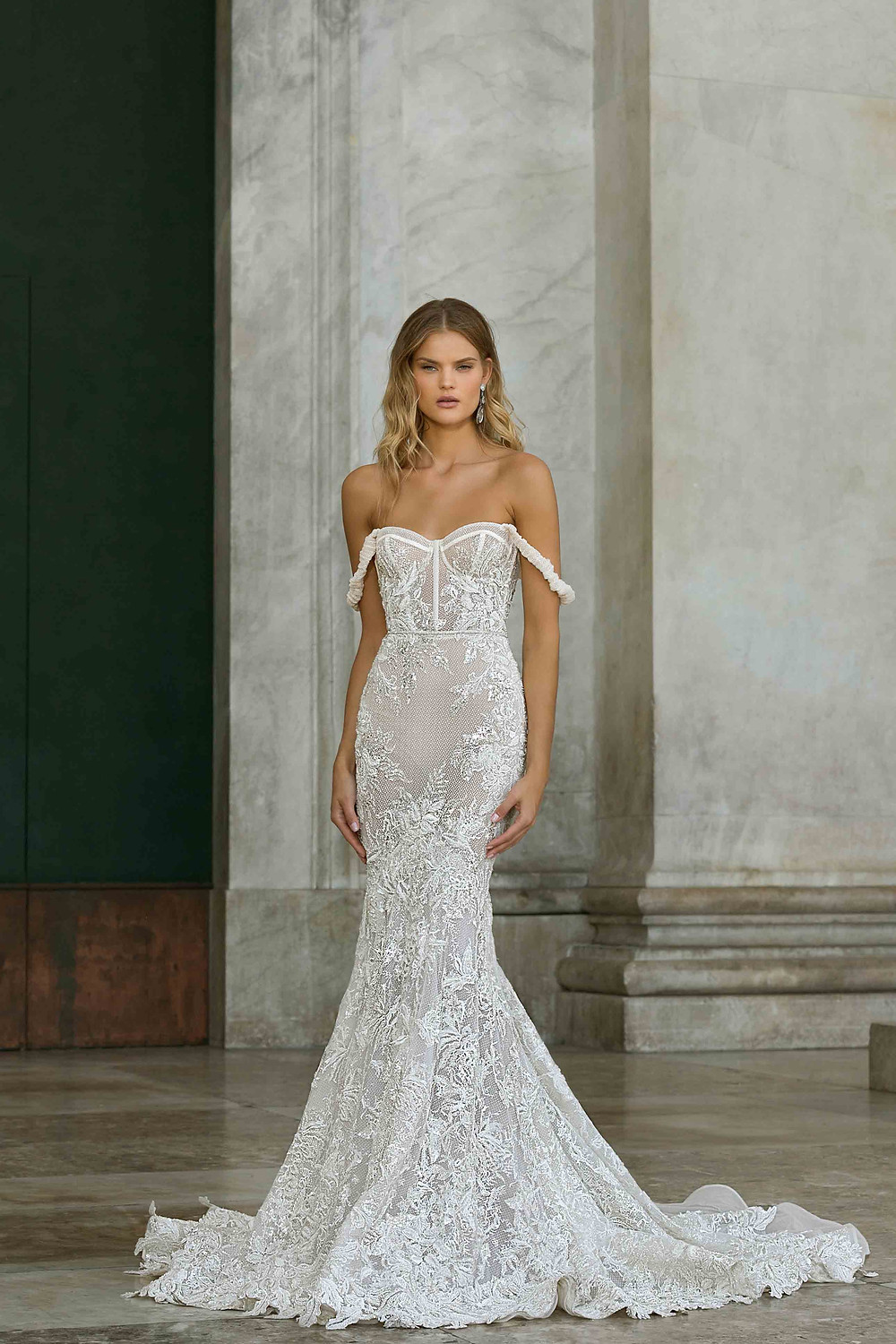 An off the shoulder, corset mermaid wedding dress with lace