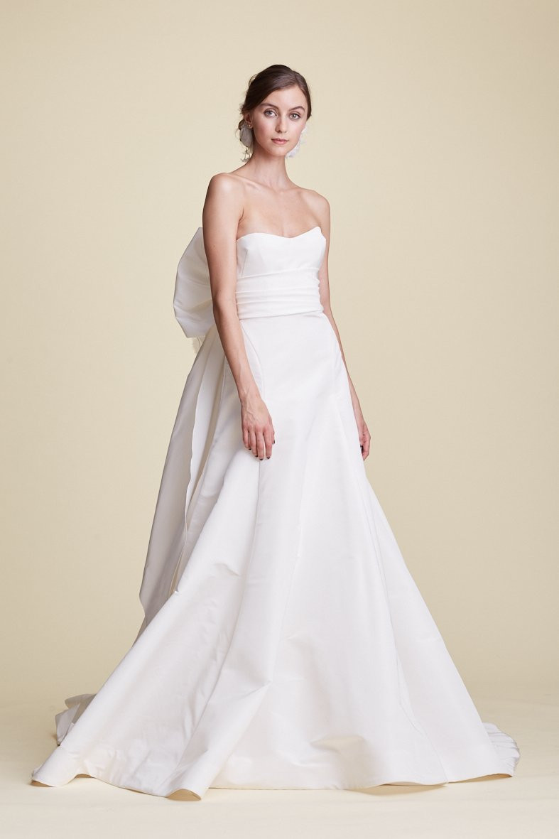A Marchesa strapless crepe A-line wedding dress with a bow
