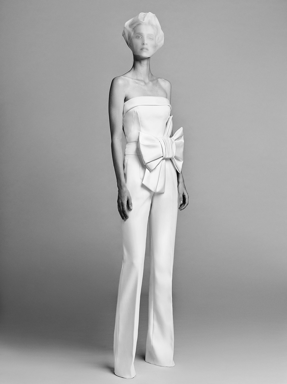 A Viktor & Rolf strapless linen wedding jumpsuit or pantsuit with a bow