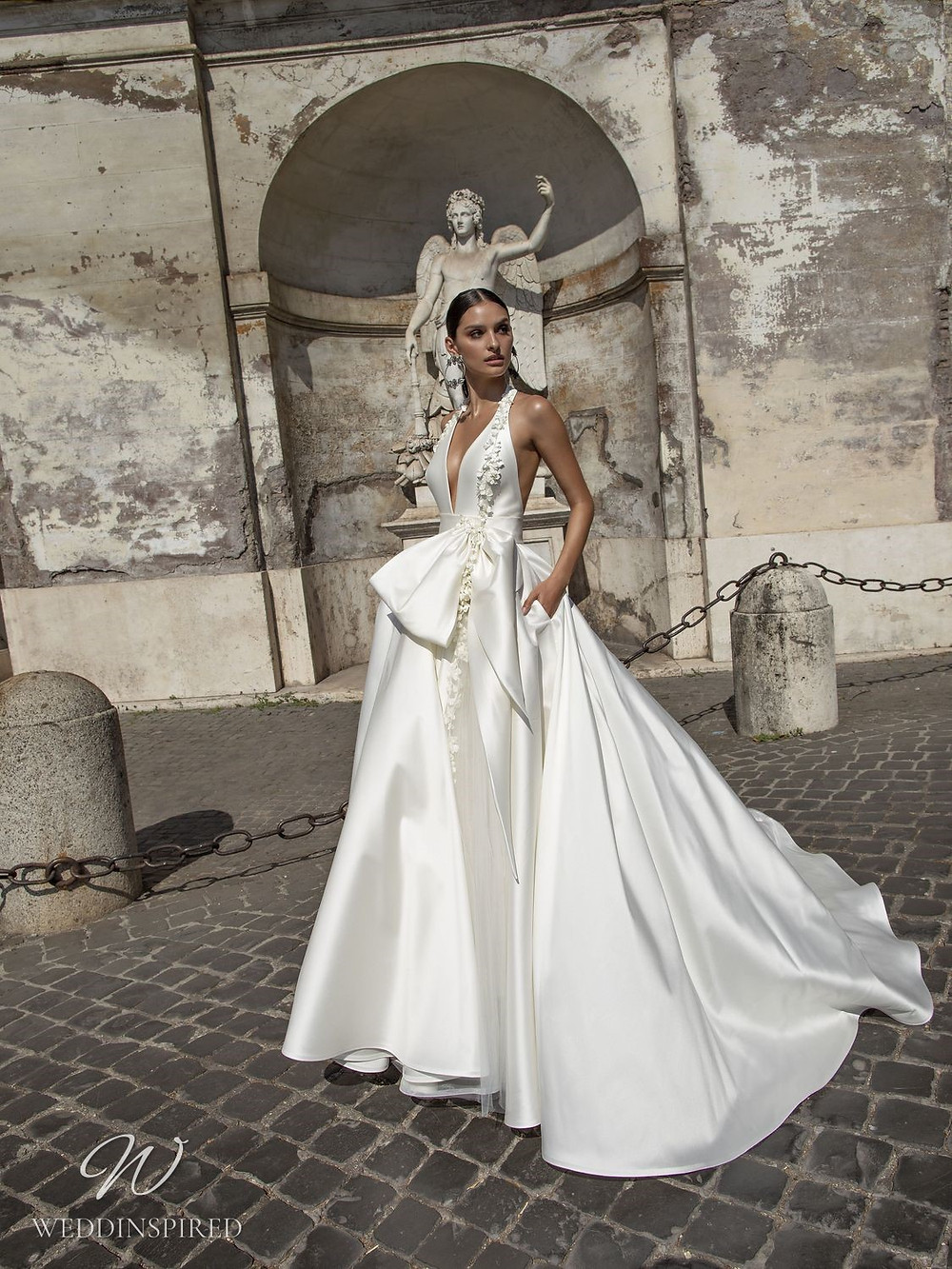 A Pinella Passaro halterneck silk satin ball gown wedding dress with a bow