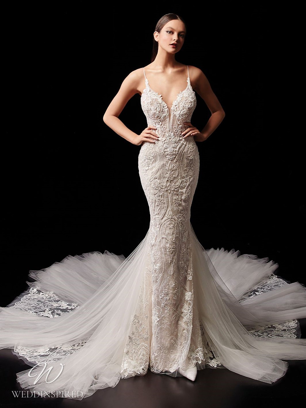 An Enzoani lace and tulle mermaid wedding dress with thin straps and a train