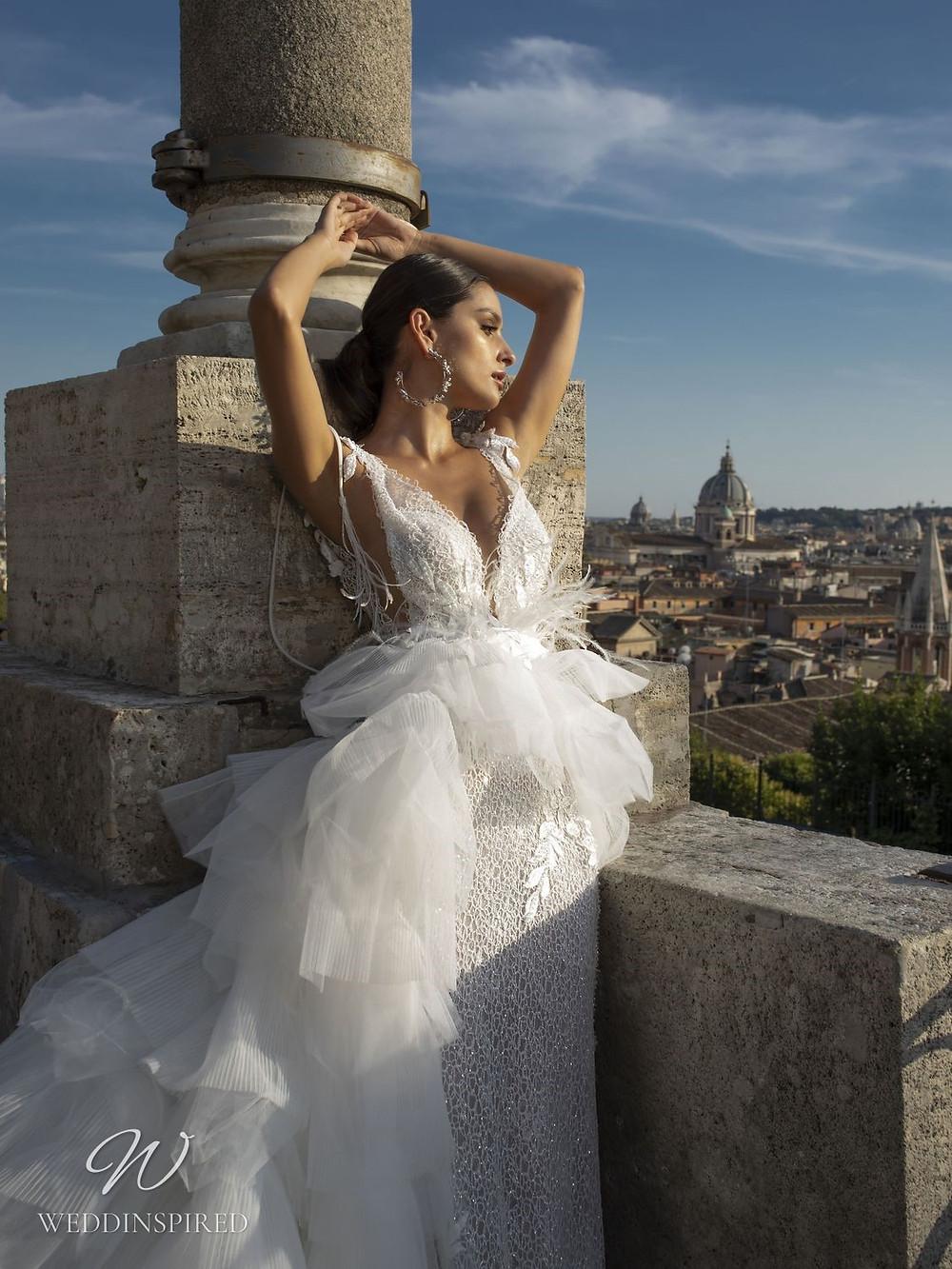 A Pinella Passaro mesh column wedding dress with a tulle detachable skirt