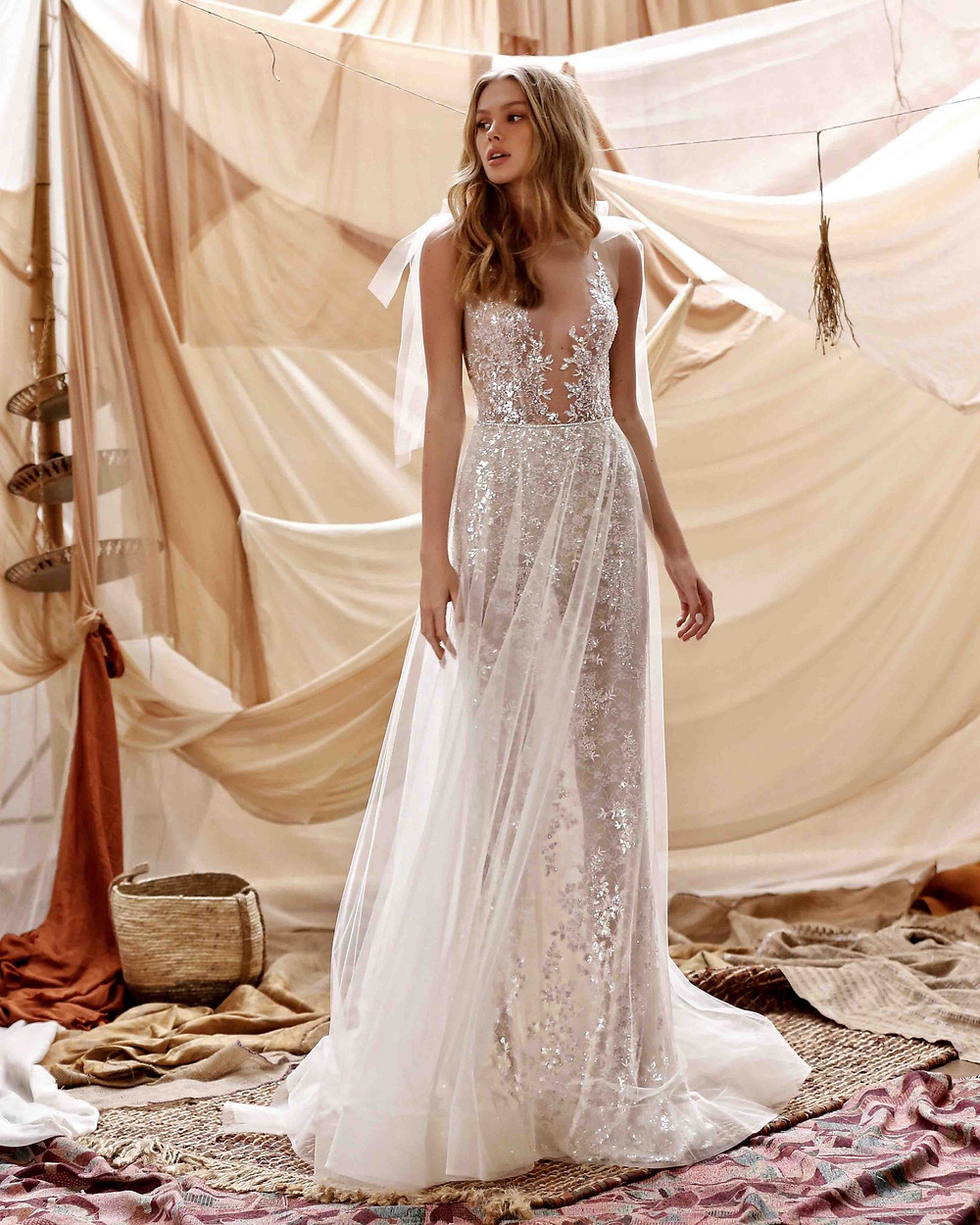 A Berta 2021 flowy wedding dress with a low V, sparkles and ribbons