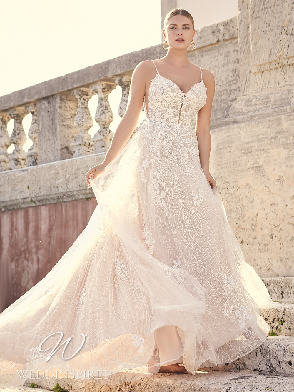 A Sottero & Midgley 2021 blush lace and tulle A-line wedding dress