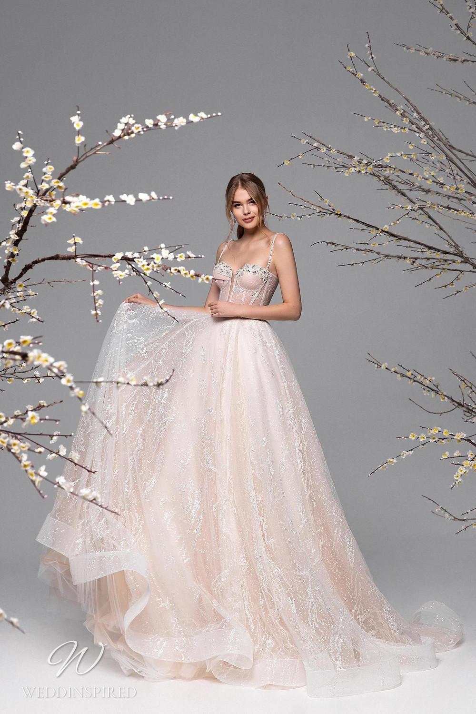 A Ricca Sposa sparkle mesh ball gown wedding dress